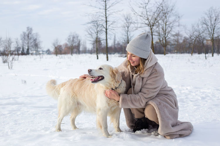 Woman with dog on snow