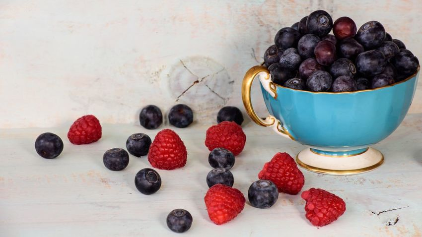 Fresh berries blueberry and raspberry in vintage tea cup on Wood table background Raspberry Blueberry EyeEm Selects Blueberry Fruit Food And Drink Food Berry Fruit Freshness Healthy Eating Sweet Food Table Raspberry Indoors  No People Dessert Close-up