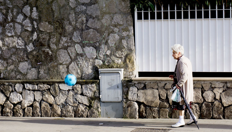 an old woman and a football on the street Ball Champion Europameisterschaft Football Funny Fussball Meisterschaft Soccer Sport Street Street Photography Street Scene Streetphotography Football Fever