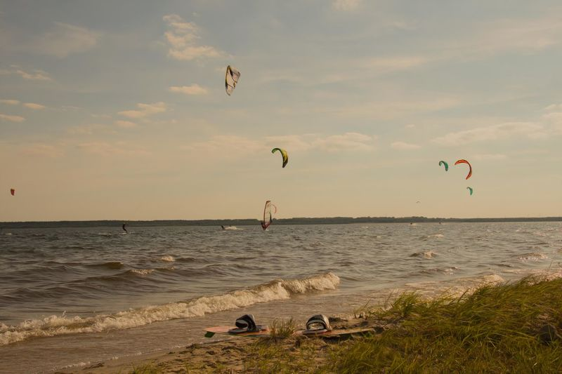 Kitesurfen at the Bärwalder Lake Kitesurfen Adventure Beach Beauty In Nature Cloud - Sky Day Extreme Sports Flying Horizon Over Water Leisure Activity Lifestyles Mid-air Nature Outdoors Parachute Real People Sand Scenics Sea Sky Sport Sunset Tranquil Scene Tranquility Water