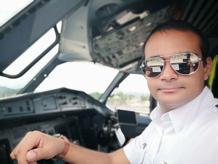 Pilot sitting in airplane