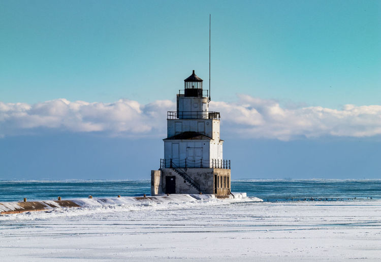 Ice, Lighthouse, and Sea Smoke Architecture Beach Beauty In Nature Building Exterior Built Structure Cloud - Sky Day Horizon Over Water Lighthouse Nature No People Outdoors Sand Scenics Sea Sky Tower Tranquil Scene Tranquility Water Wave