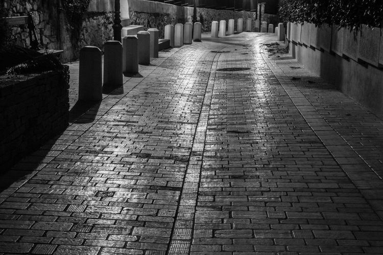 Street Pavement Walkway Way Night No People Shadow City Architecture Built Structure Pathway Paved Walkway Paving Stone Long Settlement Urban Scene vanishing point Diminishing Perspective Empty Road The Way Forward