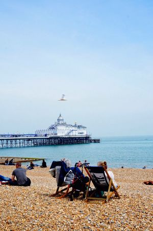 Eastbourne pier Pier Sea And Sky Seafront Seaside Beach Beachphotography Beach Photography Beach Life Beach Day Sunny Sunbathing Sunbath Sunbathingtime Seagull People Relaxing Moments Relaxing Chatting People Talking Sand & Sea People And Places. People And Places