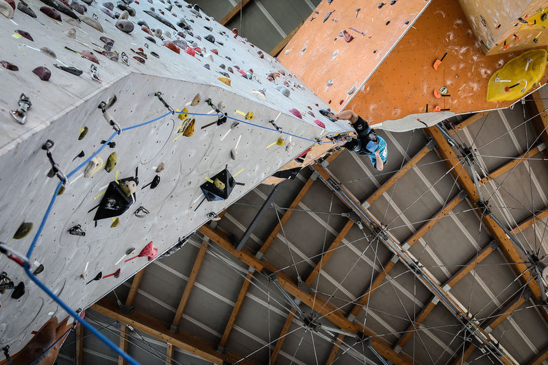 Low angle view of man climbing on wall