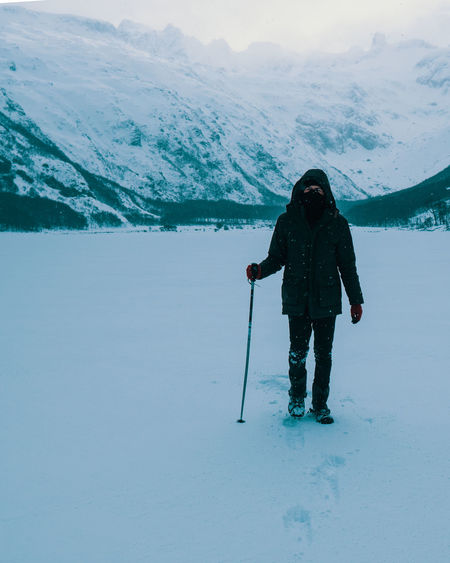 Full length of senior woman on snowcapped mountain