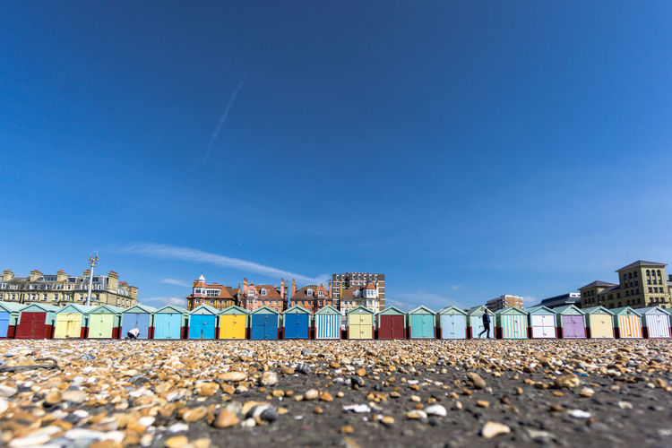 Surface level of beach huts against sky