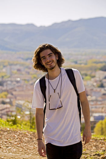 Portrait of smiling male hiker during sunny day