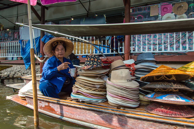 ASIA Boat Canal Casual Clothing Day Display Eating Famous Places Floating Market Hats Lifestyles Lunch Time! Multi Colored Retail  River Shop Thailand Traditional Travel Destinations Woman Woman Working