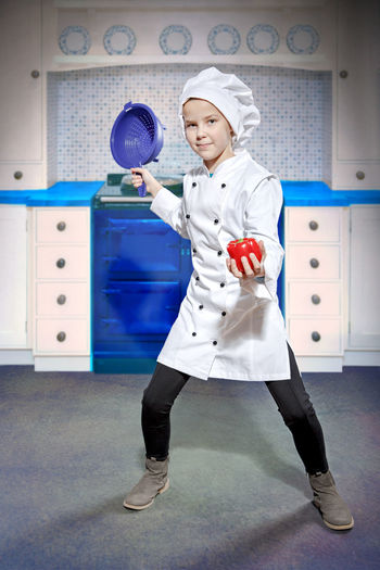 Portrait of girl standing in chef costume