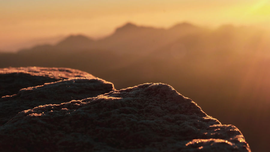 Scenic view of rock against sky during sunset