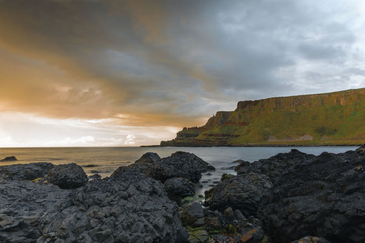 Giants Causeway, National Trust. Beach Beauty In Nature Bushmills Cloud - Sky Day Giants Causeway Horizon Over Water Mountain Nature No People Northern Ireland Northern Ireland Tourism Outdoors Rock - Object Rock Formation Scenics Sea Sky Stacks  Sunset Tranquil Scene Tranquility Water