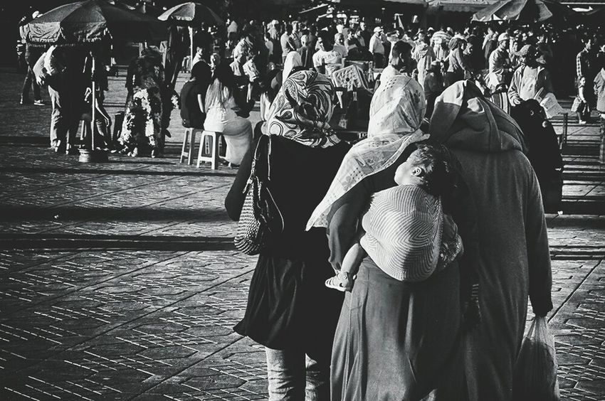 Telling Stories Differently Up Close Street Photography Blackandwhite Photography Women Who Inspire You Motherhood Morocco Memories Crowded Taking Photos From Where I Stand Malephotographerofthemonth Blackandwhite Women Of EyeEm Mothernature Streetphotography Mother And Child The Street Photographer - 2016 EyeEm Awards - Jemaa El Fnaa Marrakech Morocco Africa