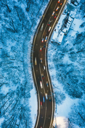 City traffic DJI X Eyeem Drone  Aerial Aerial View Europe Lithuania Winter Lietuva City Traffic City Traffic Winter Wonderland Long Exposure Road Mavic 2 Mavic 2 Pro Transportation Cold Temperature Nature Snow Architecture Mode Of Transportation Day No People High Angle View Built Structure Land Vehicle Motion Motor Vehicle Street Outdoors