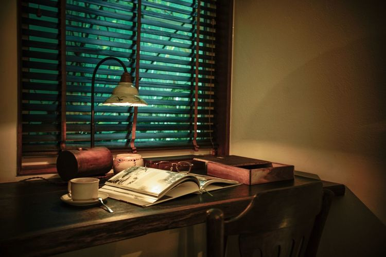 Days in saigon Table Indoors  Window Blinds Home Interior Lighting Equipment No People Furniture Electric Lamp Chair Seat Book Wall - Building Feature History My Best Photo