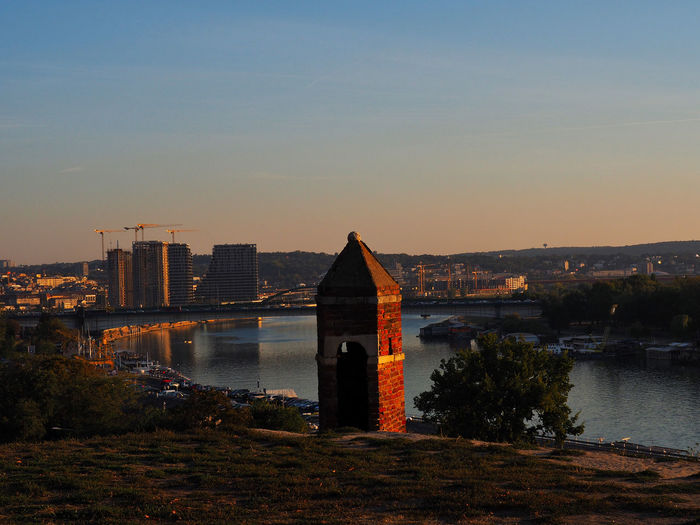 European Cities Belgrade Serbia Eastern Europe Balkans Europe Built Structure Architecture Sky Building Exterior Water River View River Nature No People Travel Destinations Copy Space Outdoors Sunset Construction Travel Photography Golden Hour Horizon City Tranquil Scene Reflections In The Water