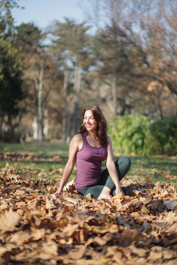 Full length of woman in park during autumn
