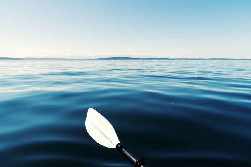 Seductive blue sea with a kayak paddle resting between strokes. Pacific Northwest  Travel Adventure Beauty In Nature Close-up Day Horizon Over Water Minimalism Nature No People Outdoor Recreation Outdoors Paddle Sea Sea And Sky Seductive Silky Sky Smooth Sports Texture Vacation Water
