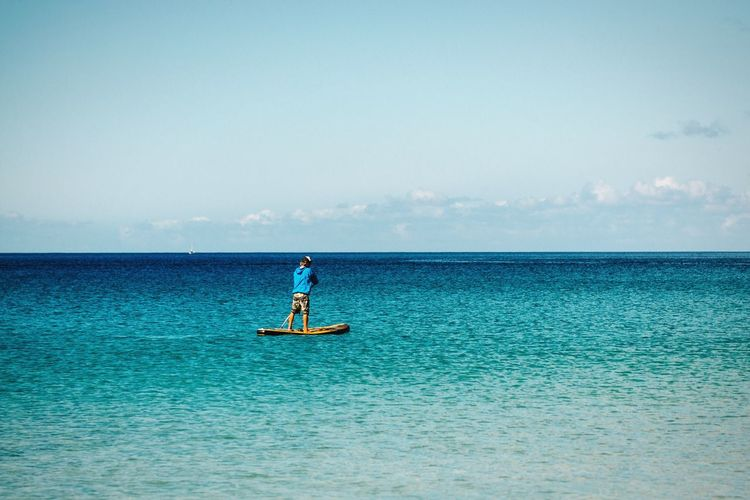 Paddling The Essence Of Summer Open Edit Sea Sea And Sky Paddling Paddleboarding Paddle Boarding Summer The Great Outdoors - 2016 EyeEm Awards Blue Blue Sea Activity Sports Watersports Ocean Fuerteventura Morro Jable Canary Islands Deep Blue Sea Man Sports Photography Sunny Day Seaside Seascape In The Sea