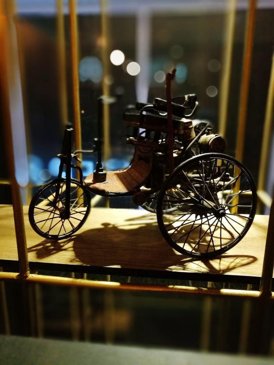bicycle, transportation, mode of transport, land vehicle, stationary, wheel, no people, indoors, night, illuminated