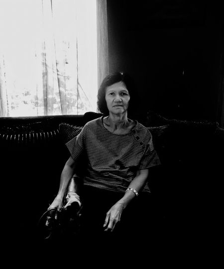 Bnw One Person Real People Portrait Looking At Camera Front View Lifestyles The Portraitist - 2019 EyeEm Awards Leisure Activity Indoors  Casual Clothing Full Length Sitting Window