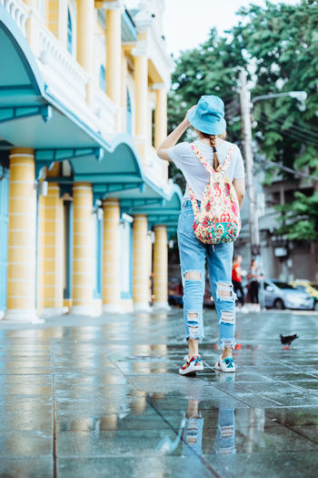 Architecture Building Exterior Built Structure Casual Clothing Child Childhood Clothing Day Females Full Length Girls Innocence Leisure Activity Lifestyles One Person Outdoors Rain Rainy Season Real People Water Women women around the world Women Portraits Womensfashion Womenswear