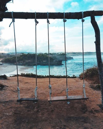 """Life is an adventure, it's not a package tour"" - Eckhart Tolle Nature Sea Swing Beach Rope Swing Beauty In Nature Reylumantouw Reyphotography Bali INDONESIA Nusalembonganisland First Eyeem Photo"