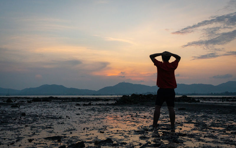 Sunset Sky One Person Scenics - Nature Standing Beauty In Nature Real People Cloud - Sky Leisure Activity Lifestyles Land Orange Color Nature Full Length Human Arm Mountain Arms Raised Tranquil Scene Rear View Outdoors
