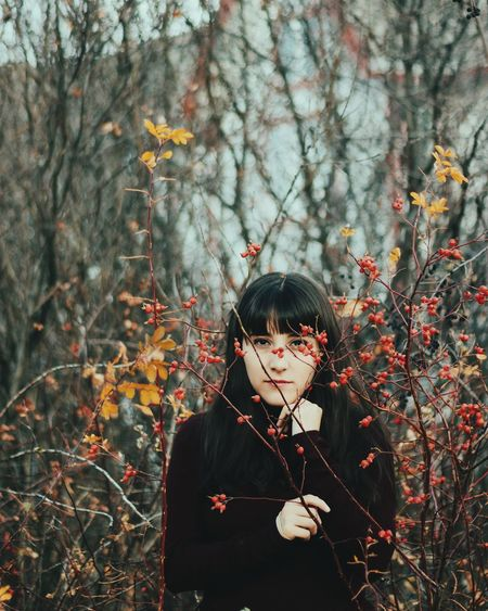 Autumn Bangs Beautiful Woman Branch Casual Clothing Day Flower Focus On Foreground Forest Front View Growth Leaf Leisure Activity Lifestyles Nature One Person One Young Woman Only Outdoors Plant Real People Standing Tree Waist Up Young Adult Young Women
