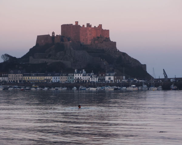 A lone swimmer and a powerful castle in the background make a lovely combination Calm Day Gorey Gorey Castle Jersey Outdoors Swimming Tranquil
