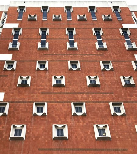 Symmetry Iphonexphotography IPhoneX Staylorphotography Acj Jail Downtown Downtown Pittsburgh Building Exterior Architecture Built Structure Window No People In A Row Building Day Low Angle View Red Outdoors Repetition Connection City Backgrounds