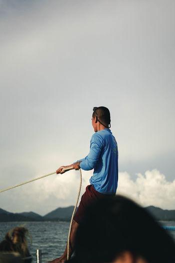 man on sea against sky