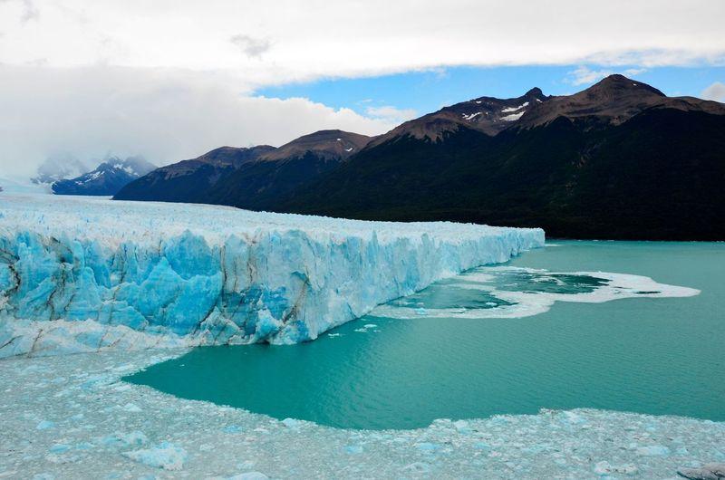 Scenic view of glacier against sky