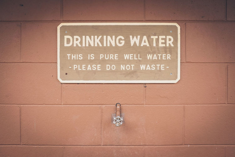 Brick Wall Camping Centered Composition Drinking Water Orange Pattern Sign Tap Warning