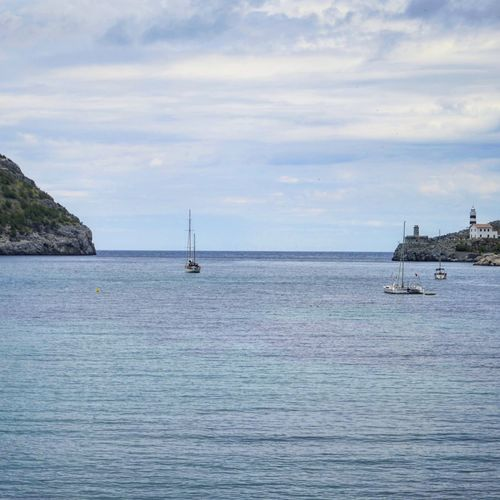 Port de Sóller Sailing Ship Water Nautical Vessel Yachting Sea Sailing Sailboat Yacht Tall Ship Mast Lighthouse Harbor Rocky Coastline Dock Boat Water Vehicle Port Fishing Boat Marina Sailing Boat