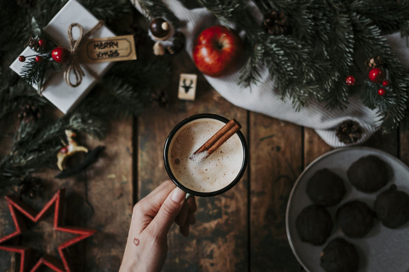 Hand Christmas One Person Holding Holiday Christmas Decoration Celebration Drink Decoration Christmas Ornament High Angle View christmas tree Lifestyles Gift Christmas Xmas Coffee Coffee - Drink Warm Drink Cinnamon Holiday Moments