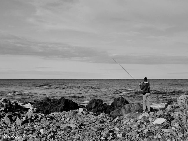 beautiful simplicity BW Beach Black And White Black And White Collection  Black And White Photography Black And White Portrait Black And White Street Photography Calm Calmness Everyday Beauty Everyday Joy Fisherman Fishing Fishing Pole Fishing Rod Horizon Over Water One Person Real People Rear View Rocks Sea Simple Photography Standing The Beauty Of Simplicity Water Weekend Activities