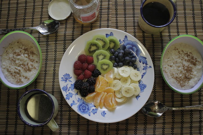 Fruit & Porridge breakfast table shot from above Banana Blueberry Bowl Breakfast Chia Seed Close-up Day Drink Drinking Glass Food Food And Drink Freshness Fruit Granola Healthy Eating Healthy Lifestyle Indoors  Kiwi - Fruit No People Ready-to-eat Smoothie Table Yogurt
