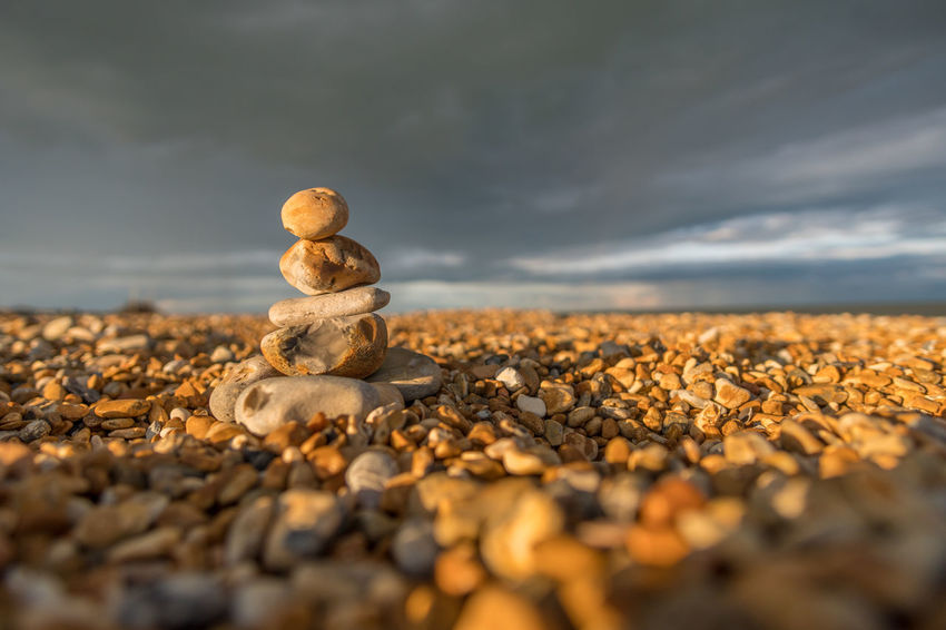 Walimex 12mm Beauty In Nature Close-up Cloud - Sky Day Large Group Of Objects Nature No People Outdoors Pebble Pebble Beach Rock - Object Scenics Selective Focus Sky Stack Stone - Object Tranquil Scene