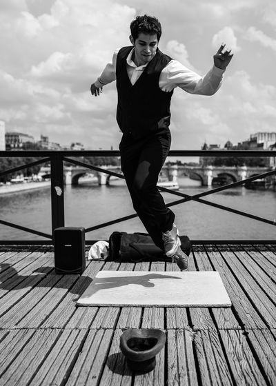 Dancing Man Pont Des Arts Seine Architecture Bridge Built Structure Casual Clothing Cloud - Sky Dancer Day Front View Full Length Jumping Leisure Activity Lifestyles Nature One Person Outdoors Pier Railing Real People River Sky Street Performer Water Wood - Material Young Adult The Photojournalist - 2018 EyeEm Awards The Great Outdoors - 2018 EyeEm Awards The Traveler - 2018 EyeEm Awards The Portraitist - 2018 EyeEm Awards The Street Photographer - 2018 EyeEm Awards