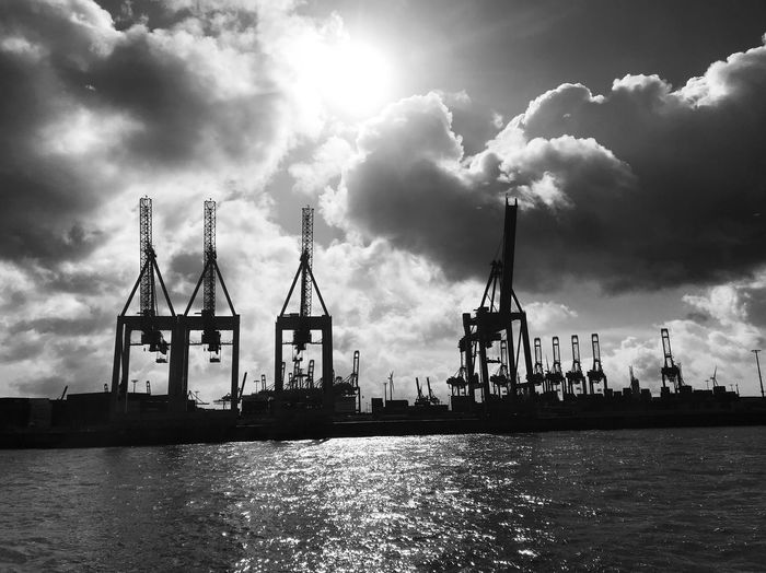 Rough. Cloud - Sky Sky Built Structure Waterfront Architecture Water Building Exterior Crane - Construction Machinery Day Nautical Vessel Commercial Dock Outdoors No People Industry Harbor Sea Travel Destinations Mast Nature Cityscape