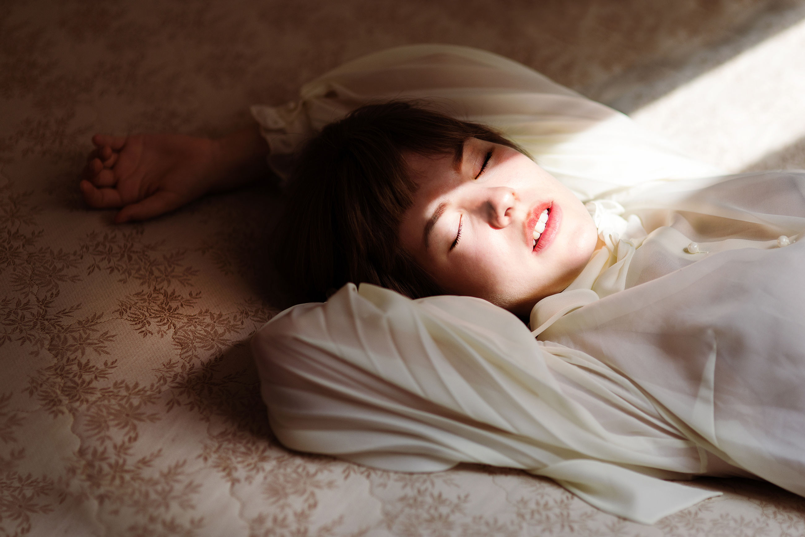 indoors, bed, relaxation, person, lying down, sleeping, home interior, bedroom, lifestyles, childhood, resting, innocence, eyes closed, young adult, comfortable, casual clothing, baby, high angle view