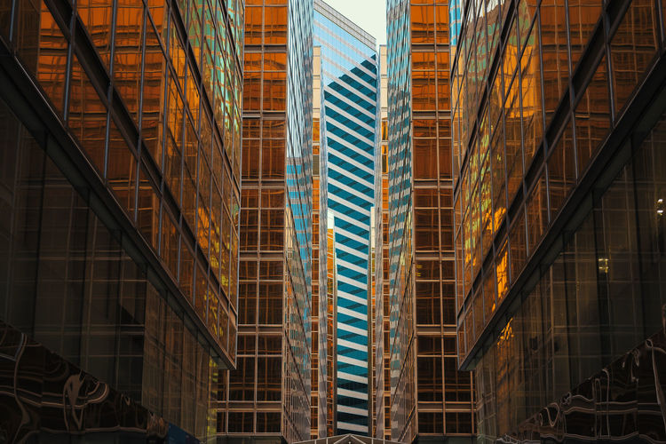 Low angle view of modern glass buildings in city