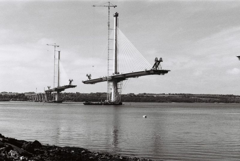 The new Forth crossing under Construction Bridge Building Crane Crane - Construction Machinery Development Firth FirthOfForth Fortheloveofblackandwhite Low Angle View Outdoors Riverbank Sea Suspension Bridge