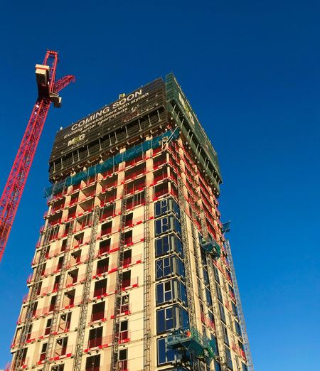 London Housing Housing Rental Only Developers Homebuilding Construction London Architecture Low Angle View Building Exterior Built Structure Blue Window Day Crane - Construction Machinery Clear Sky Construction Site Outdoors No People Sky
