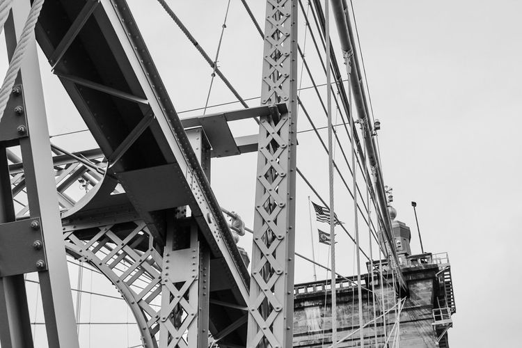 You can hear a lot with the world on silent... Ohio Flag Blackandwhite Photography Blackandwhite Ohioriver Roebling Roebling Suspension Bridge Queencity 513 Cincinnati Cincinnati Ohio Wessography Low Angle View Built Structure Architecture Day Sky Outdoors No People EyeEmNewHere