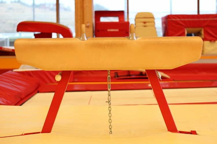 Close-up of empty chairs and table