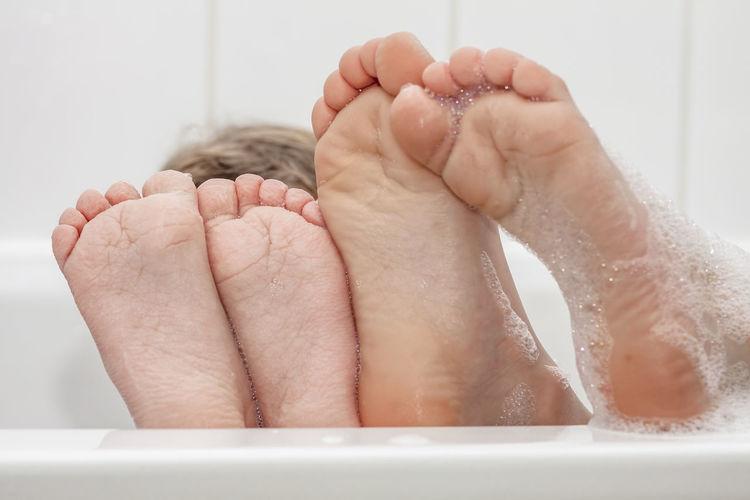 Closeup of wrinkeled feet on edge of bubble bathtub Bath Bathing Foot Hygiene Tub Tube Washington, D. C. Young Bathroom Bathtub Caucasian Child Childhood Clean Healthy Eating Indoors  Shampoo Soap Wet Wrenkled Wrinkled Wrinkled Skin