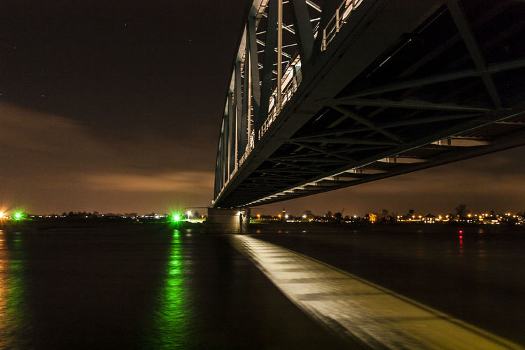 Night Lights Night Photography Riverside Skyline Architecture Bridge - Man Made Structure Built Structure City Connection Horizon Over Water Illuminated Night No People Outdoors River Riverbank Road Sky Transportation Underneath Water