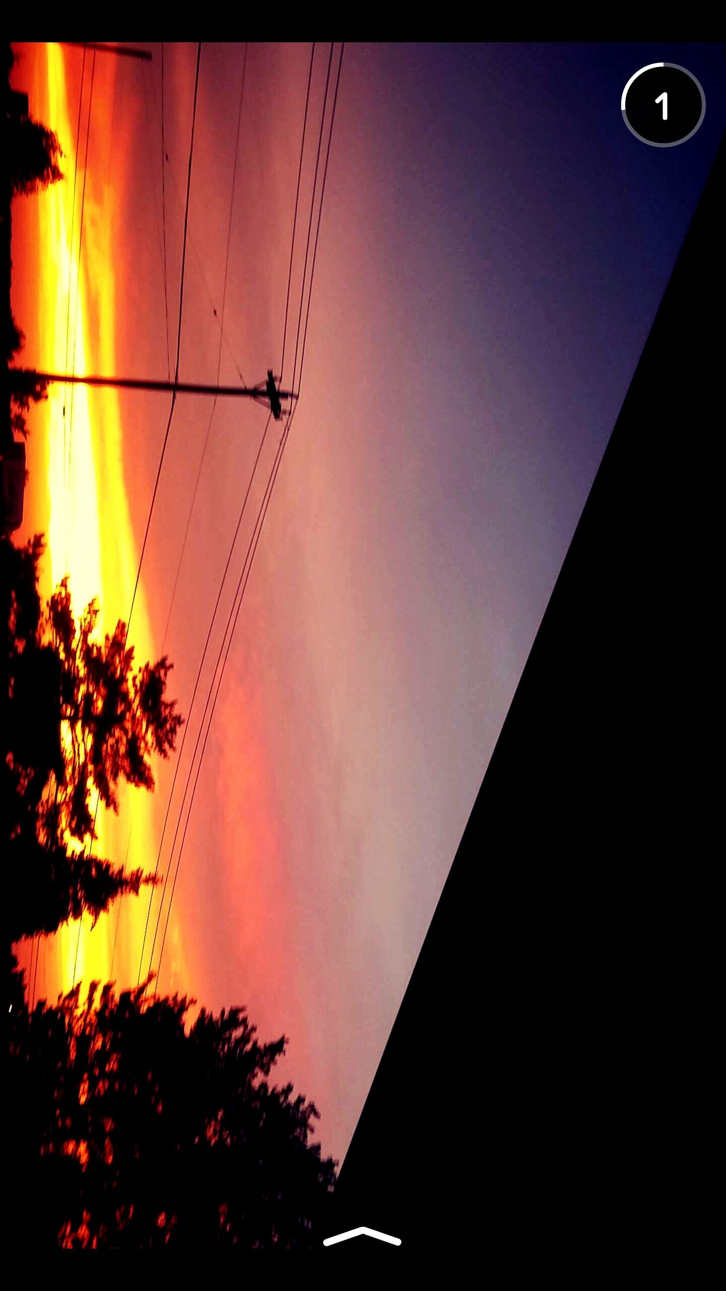 low angle view, sunset, silhouette, sky, tree, power line, orange color, electricity, built structure, architecture, building exterior, cable, auto post production filter, street light, connection, dusk, outdoors, no people, power supply, electricity pylon